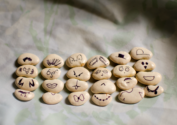 Drawing on beans to make mix and match bean friends are a fun and simple idea for a craft activity for kids using beans